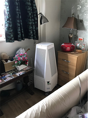 Image 1. Mobile UV air cleaner located into a resident's room
