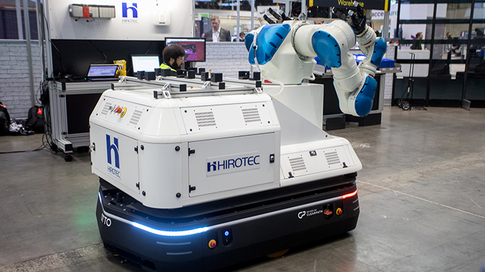 The Hirotec robot uses two arms to pick up heavy boxes of materials and move them to where humans need them to be (Credit: PTC)