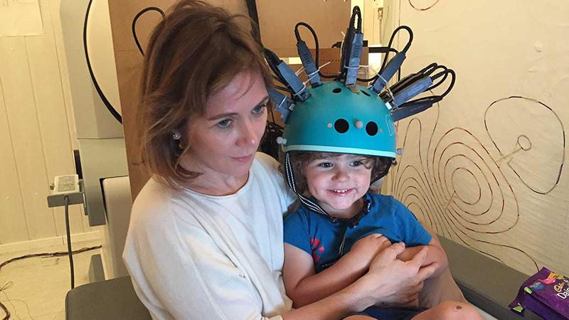 The bike helmet-style MEG scanner can scan children's brains (Credit: Professor Rebeccah Slater)