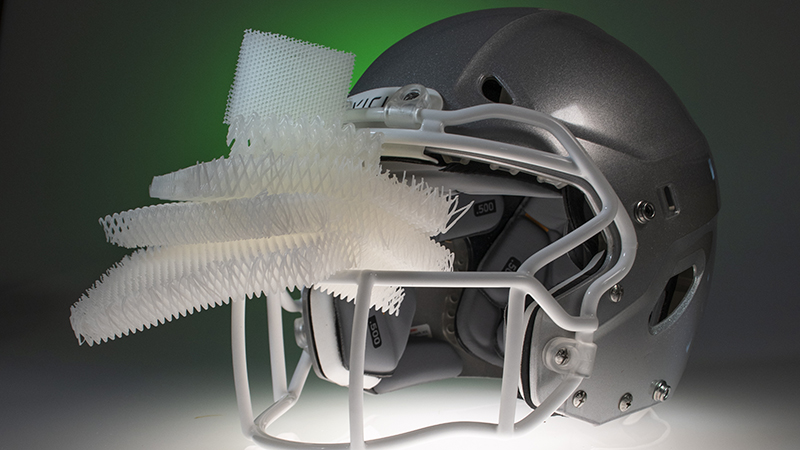 The microlattice, protruding from the helmet, could replace foams in helmets, vehicles and electronics (Credit: HRL Laboratories, LLC)