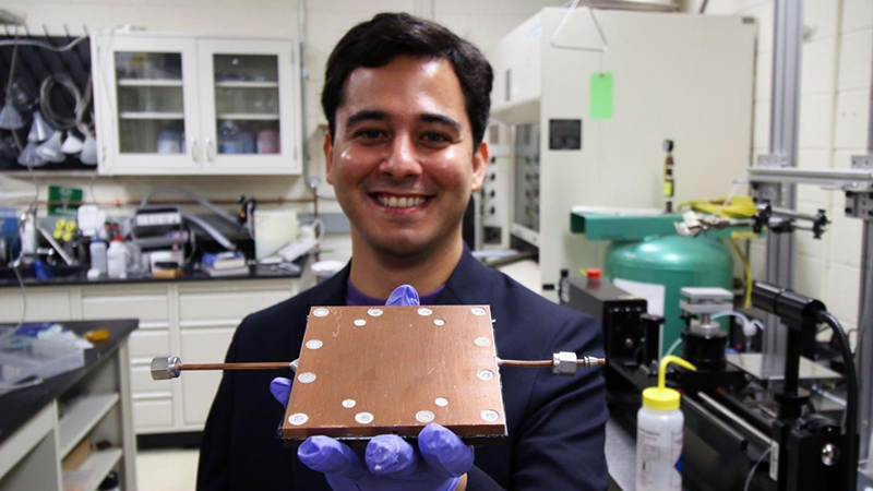 Lab member Mojtaba Edalatpour shows the thermal diode developed by Boreyko's team (Credit: Virginia Tech)
