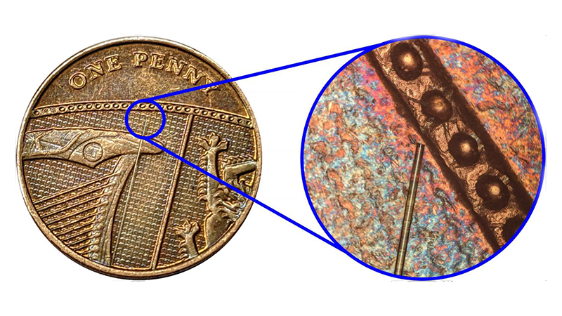 The optical sensor has a diameter of 125 micrometres – approximately the size of a human hair. The photo shows it against a penny for perspective (Credit: Dr Salvatore La Cavera)