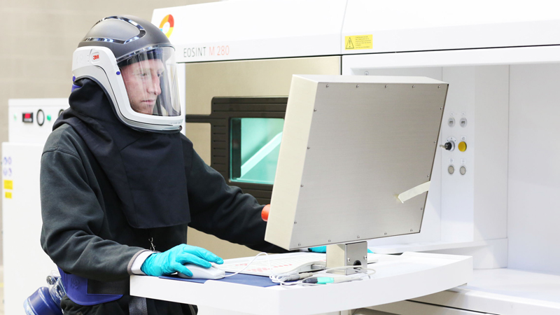 An engineer uses a metal printer at the Manufacturing Technology Centre (Credit: MTC)