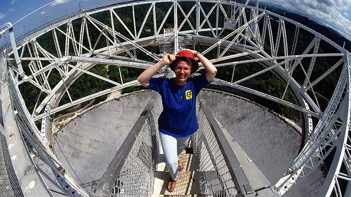 Astronomer Jill Tarter stands on the platform above the 1000-foot radio telescope in Arecibo, Puerto Rico (Credit: Roger Ressmyer/Corbis/VCG)