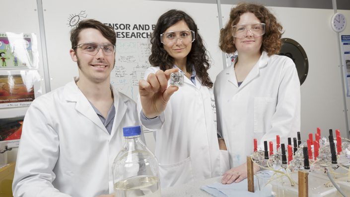 Researchers Jon Chouler and Mirella Di Lorenzo with lecturer Petra Cameron test the microbial fuel cell (Credit: University of Bath)