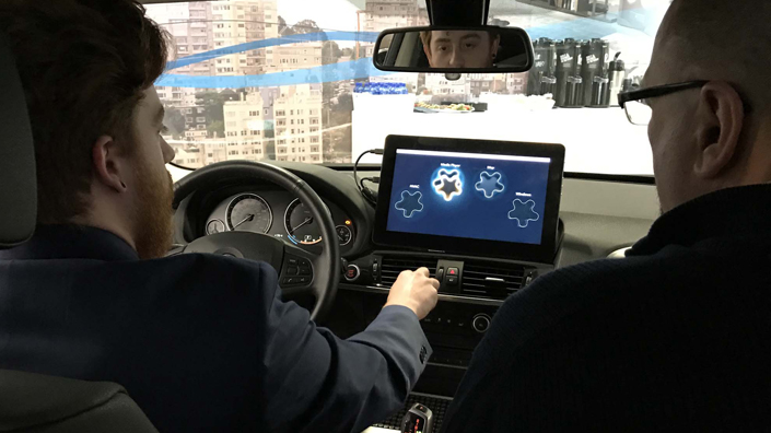 Controlling in-car infotainment system with hand gestures (Credit: Harman International Industries)