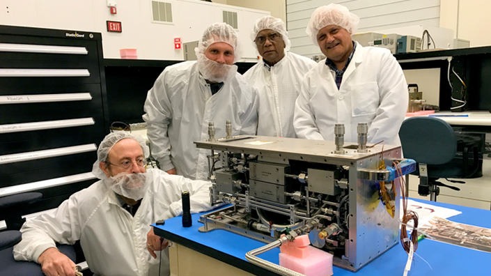 Issam Mudawar (left) inspects one of the modules of the Flow Boiling and Condensation Experiment (Credit: Purdue University)
