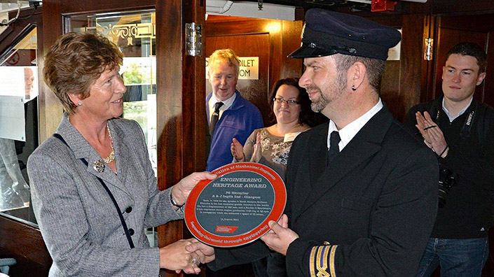 Professor Pollock presents the IMechE heritage award to the ship's then chief engineer Ken Henderson