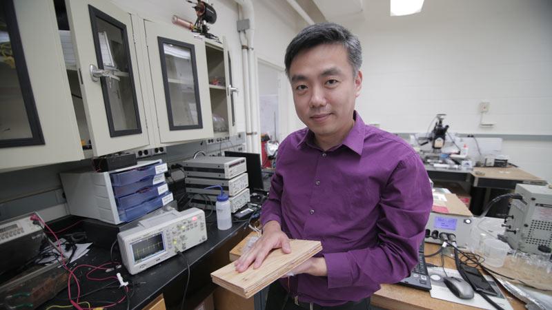 Professor Xudong Wang with floor power panel. PHOTO: STEPHANIE PRECOURT