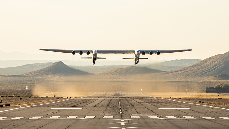 The Roc carrier plane from Stratolaunch has the largest wingspan of any aircraft in the world. Photo from an earlier test flight (Credit: Stratolaunch)
